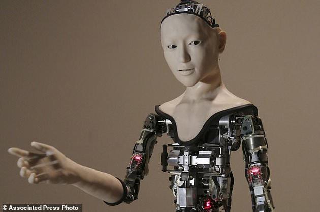 """图为在东京国家新兴科学与创新博物馆展出的类人型机器人""""Alter""""。计算机科学家和语言学家称,随着机器变得越来越聪明,幽默感也许是使人类区别于机器的最后一项特征。"""